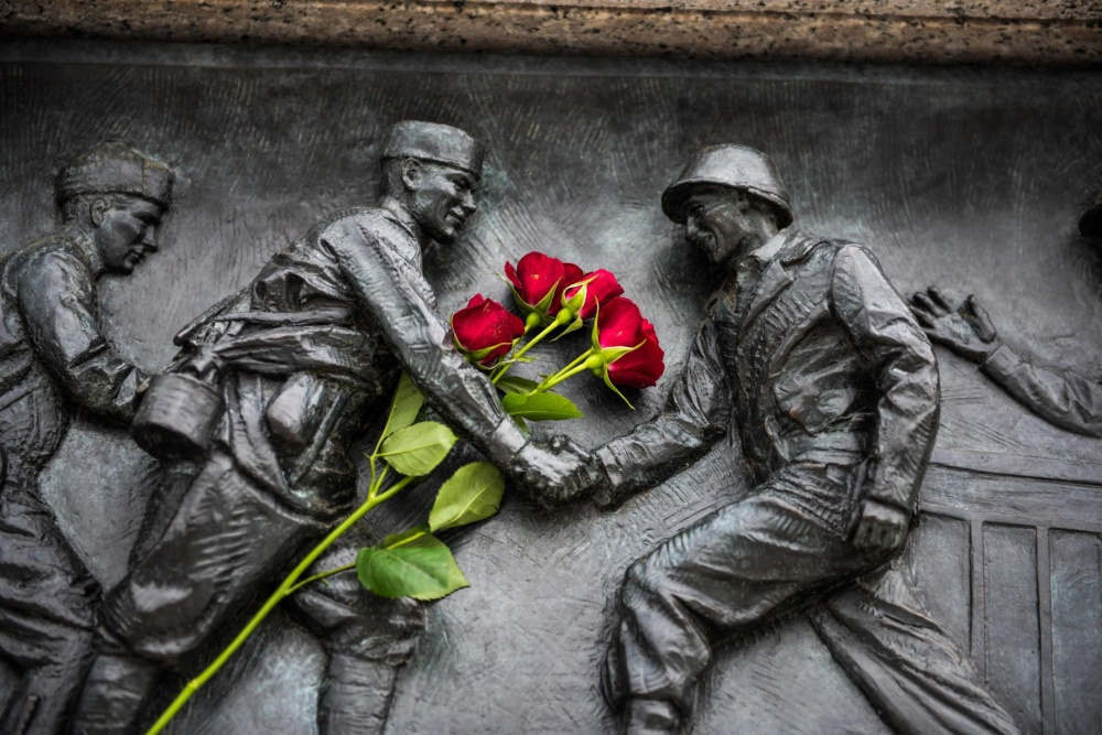 Red roses placed on the National World War II Memorial during the Victory in Europe Day observance at the memorial in Washington, May 8, 2019