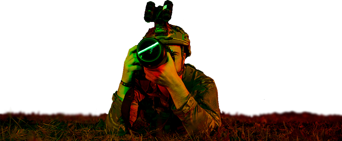 Soldier set up with camera, capturing a photo.